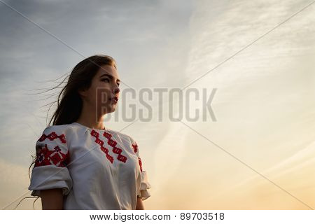 Young Woman In Slavic Belarusian National Original Suit Outdoors