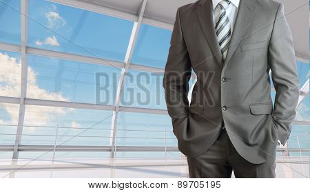 Businessman body with arms in pockets