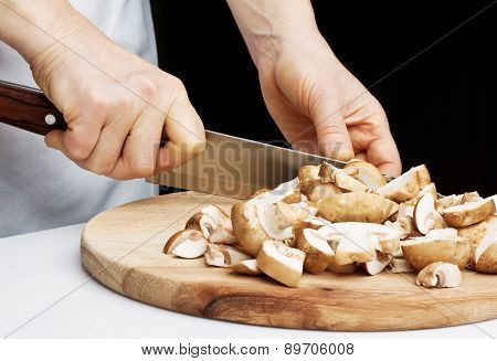Cutting the chestnut mushrooms into thin slice