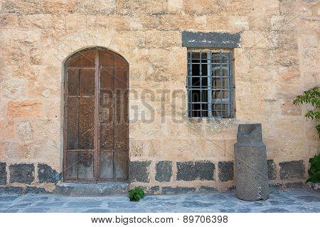 Ancient Wooden Door Set In Stone Wall