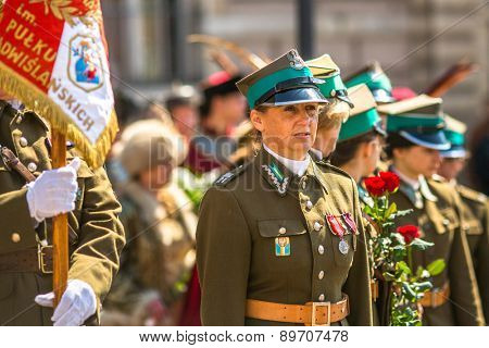 KRAKOW, POLAND - MAY 3, 2015: Unidentified participants annual of Polish national and public holiday the May 3rd Constitution Day. Holiday celebrates declaration of the Constitution of May 3, 1791.