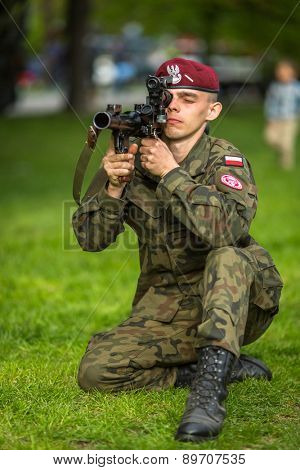 KRAKOW, POLAND - MAY 3, 2015: Polish soldier during demonstration of the military and rescue equipment during annual Polish national and public holiday the Constitution Day May 3rd.