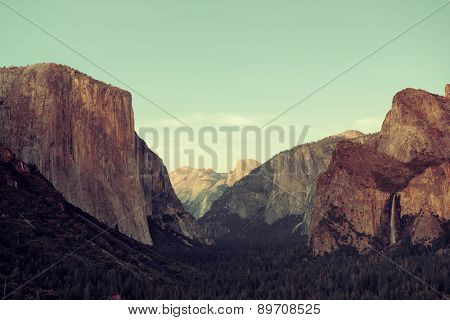 Yosemite Valley at sunset with mountains and waterfalls