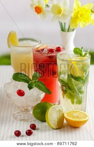 Three glasses of refreshing drink Mohito