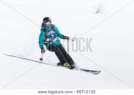 Girl Skier Rides the Mountains. Russia, Far East, Kamchatka Peninsula