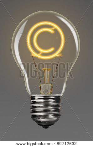 bulb with glowing copyright sign inside of it, creativity concept