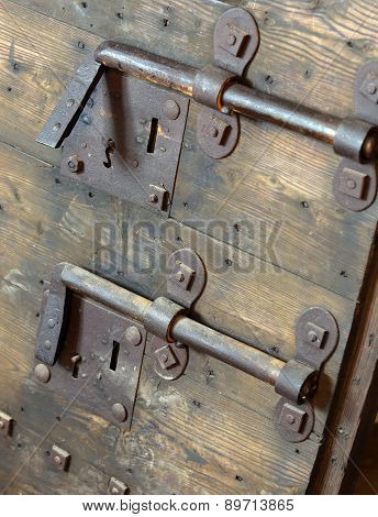 Old Lock With Big Deadbolt To Close The Door Of The Medieval Castle