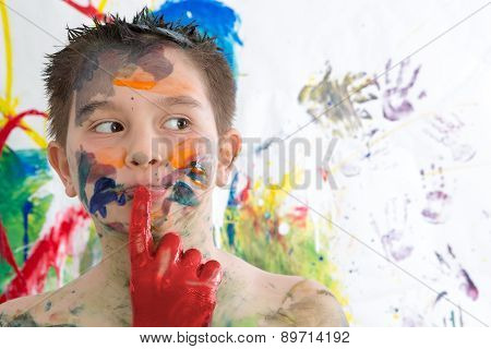 Thoughtful Creative Little Boy Covered In Paint