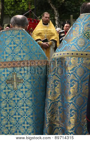 PRAGUE, CZECH REPUBLIC - MAY 28, 2012: Orthodox priests attend the orthodox service in front of the Dormition Church at the Olsany Cemetery in Prague, Czech Republic.