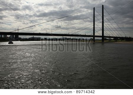 DUSSELDORF, GERMANY - AUGUST 6, 2012: Bridge over the Rhine River in Dusseldorf, North Rhine-Westphalia, Germany.