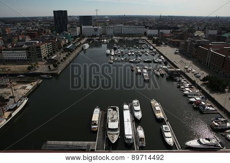 ANTWERP, BELGIUM - AUGUST 12, 2012: Yachts moored in the Willem Dock pictured from the Museum aan de Stroom in Antwerp, Belgium.