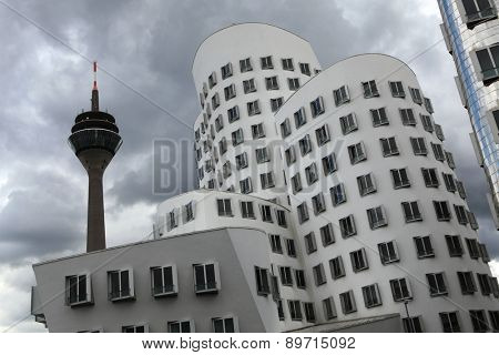DUSSELDORF, GERMANY - AUGUST 6, 2012: Neuer Zollhof (New Custom) designed by architect Frank Gehry in the Medienhafen District in Dusseldorf, North Rhine-Westphalia, Germany.