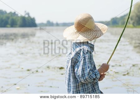 Angler Boy Is Chumming Handmade Fishing Rod