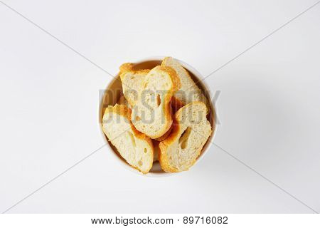 overhead view of cut french baguette in the bowl