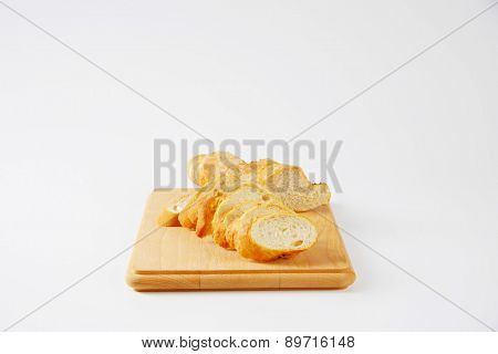 crispy french baguette, served on the wooden cutting board