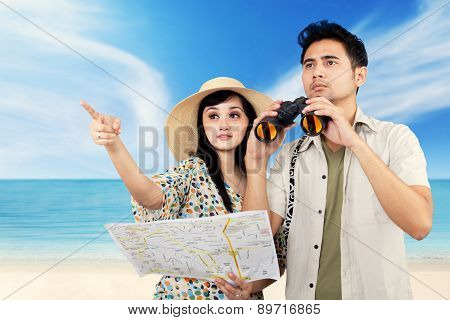 Two Tourists Sightseeing At Beach