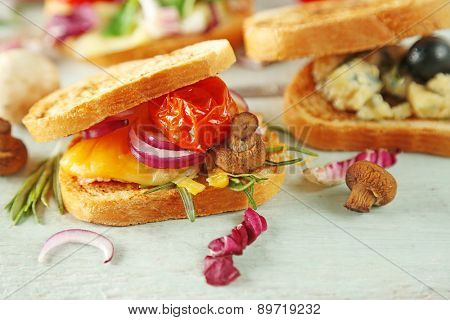 Tasty sandwiches on wooden table, close up