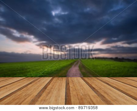 Countryside Landscape Path Leading Through Fields Towards Dramatic Beautiful Sky With Wooden Planks