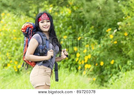Pretty Woman With Backpack In Nature