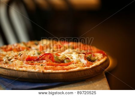 Delicious pizza on table in cafe