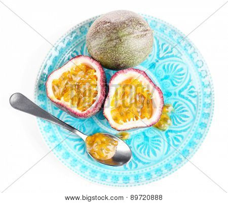 Passion fruit on plate isolated on white