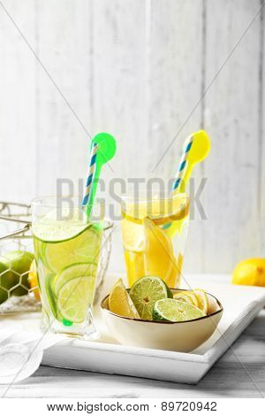 Cocktails with fresh citrus fruits on wooden background