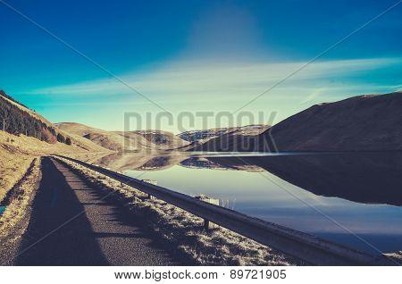 Empty Road Beside A Lake