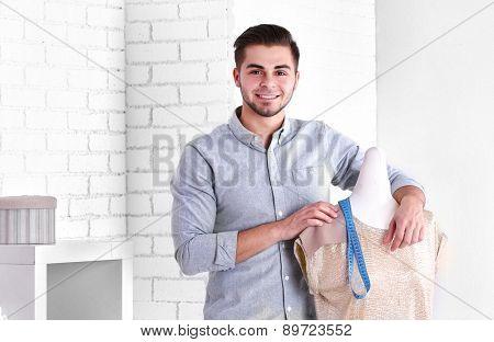 Young man fashion designer in studio