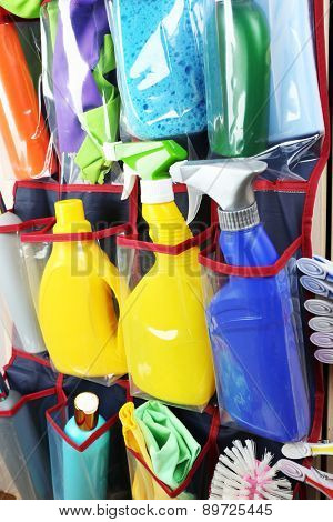 Household chemicals in holder, closeup