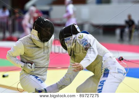 ST. PETERSBURG, RUSSIA - MAY 2, 2015: Daniele Garozzo of Italy (left) vs Giorgio Avola of Italy in the quarterfinal of International fencing tournament St. Petersburg Foil, the stage of FIE World Cup