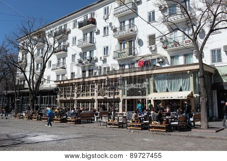 ODESSA, UKRAINE - MARCH 23, 2015: People resting in the restaurant Compote on Deribasovskaya street. The street is the main tourist attraction of the city with dozens of cafes, restaurants, and shops