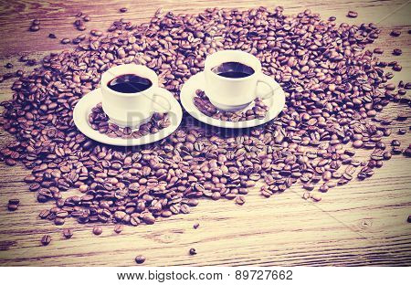 Vintage Filtered Photo Of Two Coffee Cups.