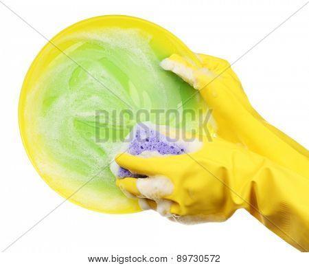 Female hand washing dish isolated on white