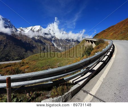 Austrian Alps. Excursion to the picturesque panoramic way Grossgloknershtrasse. Sunny day in early autumn. Great highway winds between hillsides yellowed.  The picture was taken Fisheye lens