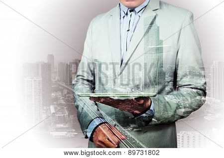 Double Exposure Of City And Businessman On The Phone
