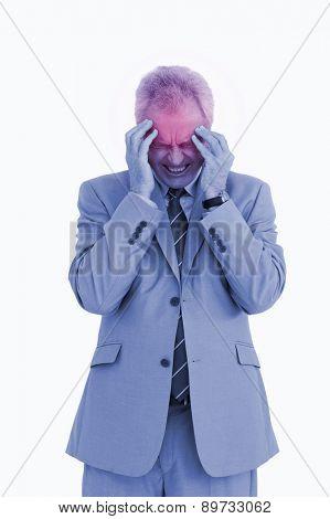 Mature tradesman experiencing a headache against a white background