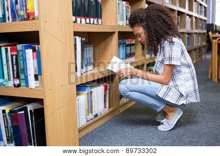 Student reading book in library at the university