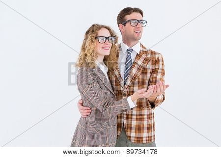 Happy geeky hipster couple holding their hands on white background