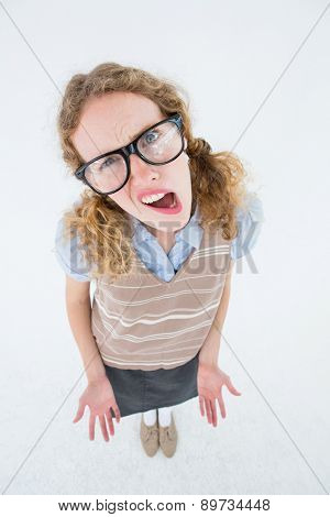 Confused geeky hipster woman on white background