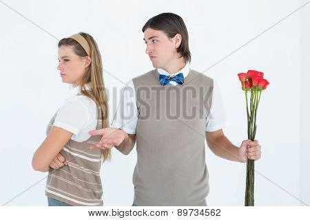 Geeky hipster couple not talking after argument on white background