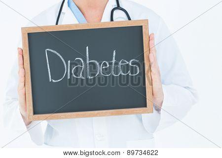 Doctor holding blackboard on white background