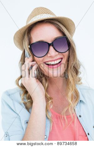 Smiling woman calling with her smartphone on white background