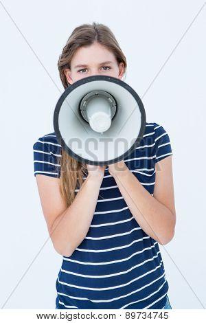 Woman speaking through a loudspeaker on white background