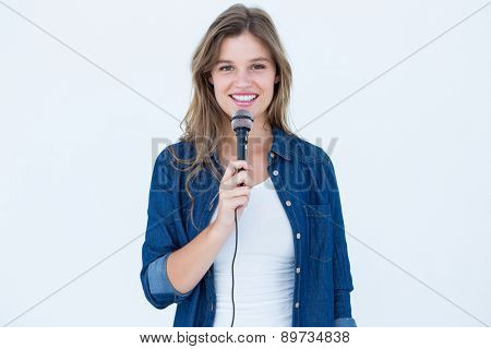 Woman singing with a microphone on white background