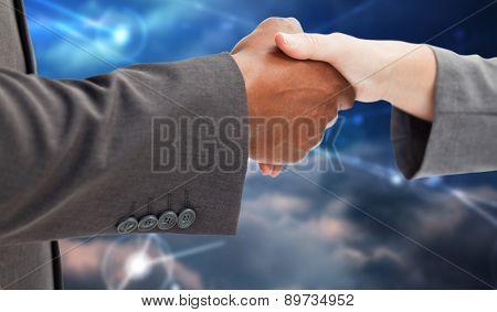 Business handshake against lines against glowing sky
