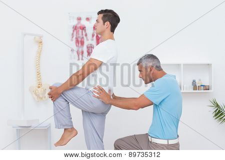 Doctor examining his patient back in medical office