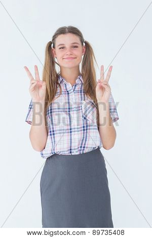 Geeky hipster smiling at camera on white background