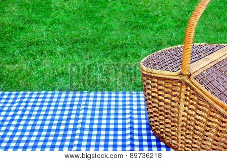 Picnic Basket On The Table With Blue White Tablecloth