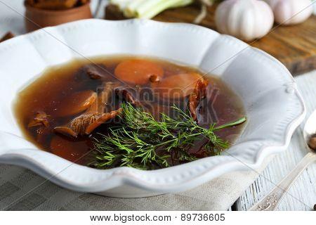 Mushroom soup on wooden table, closeup
