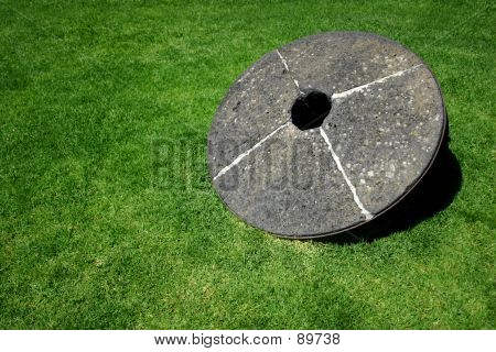 Millstone On Grass